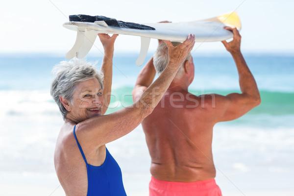 Bonitinho maduro casal prancha de surfe praia Foto stock © wavebreak_media