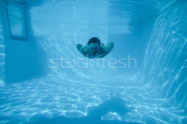 男 スイミング 水中 リゾート スイミングプール 休日 ストックフォト © wavebreak_media