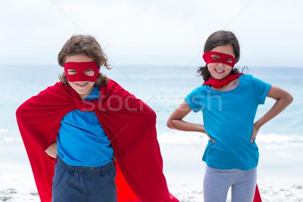 Boldog testvérek szuperhős jelmez tengerpart kéz Stock fotó © wavebreak_media