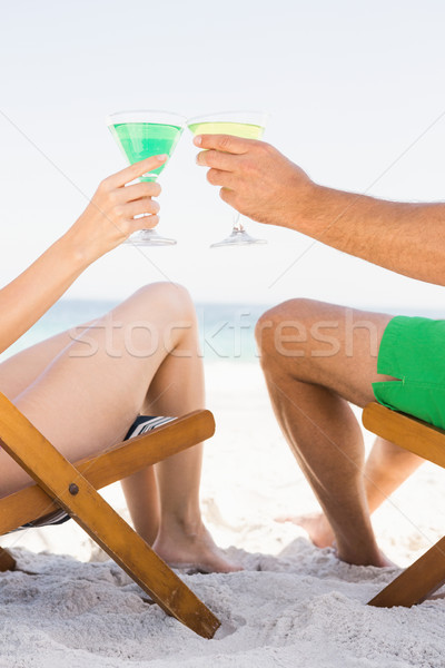 Casal sessão potável cocktails praia mulher Foto stock © wavebreak_media