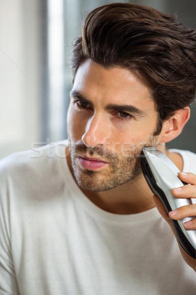 Man shaving with trimmer Stock photo © wavebreak_media