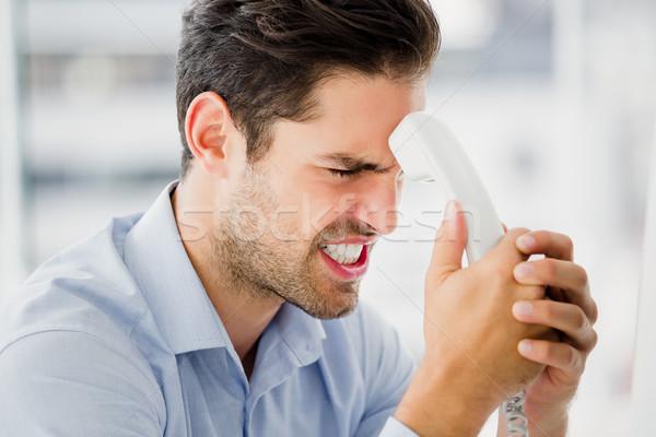 бизнесмен телефон служба человека Сток-фото © wavebreak_media