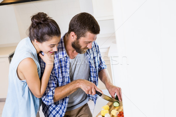 Couple chopping vegetables in kitchen Stock photo © wavebreak_media