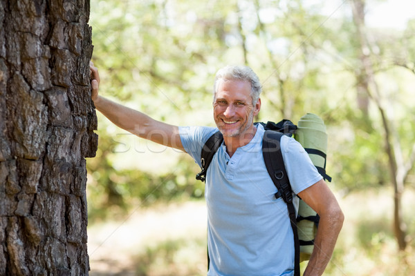 Hiker smiling and posing against a tree Stock photo © wavebreak_media