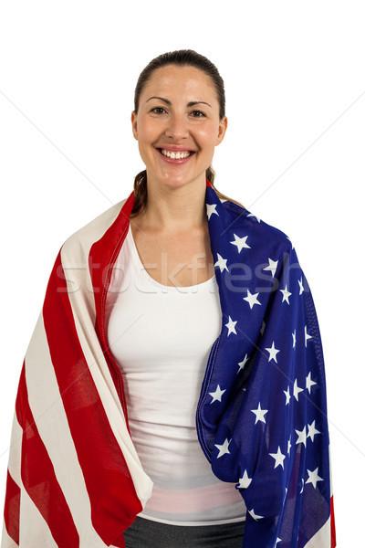 Female athlete with american flag wrapped around his body Stock photo © wavebreak_media