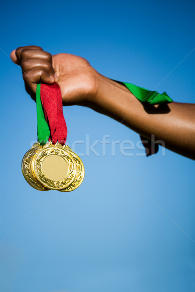Athlete hand showing his gold medals Stock photo © wavebreak_media
