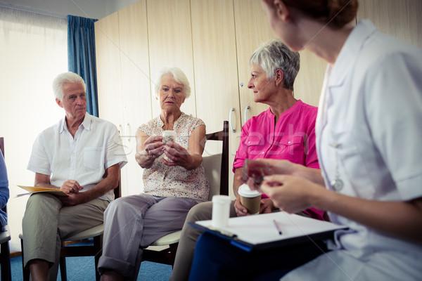 Seniors talking with nurse about medication Stock photo © wavebreak_media