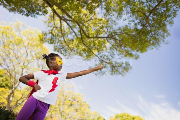 Dziewczynka latać superhero kostium parku kobieta Zdjęcia stock © wavebreak_media