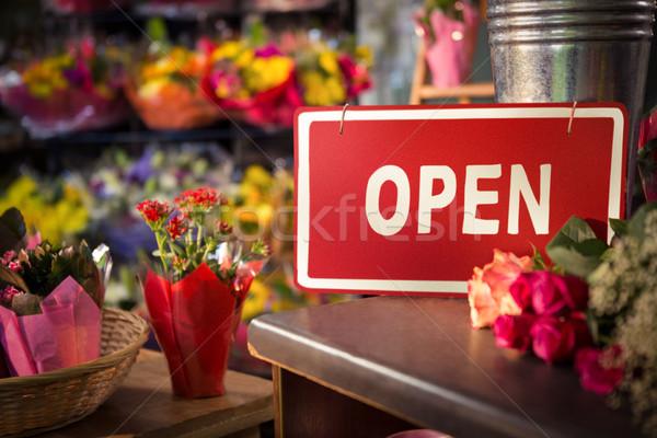 Open signboard on table Stock photo © wavebreak_media