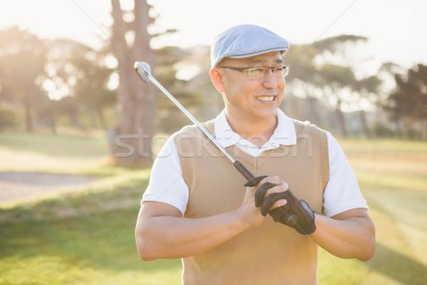 Sportsman looking away with his golf club Stock photo © wavebreak_media