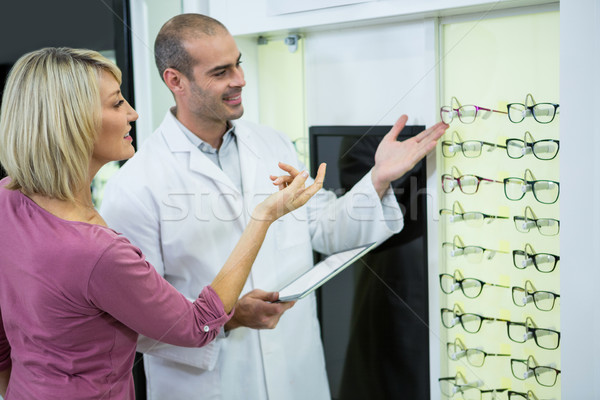 Optometrist consulting a customer about spectacles and frames Stock photo © wavebreak_media