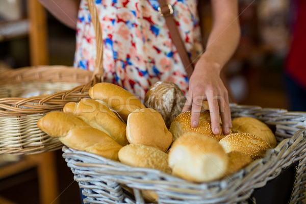 Mid section of woman selecting bread Stock photo © wavebreak_media