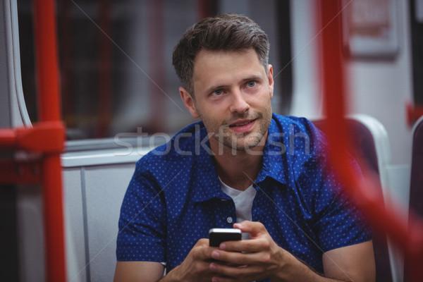 Jóképű férfi mobiltelefon vonat utazás szeretet férfi Stock fotó © wavebreak_media