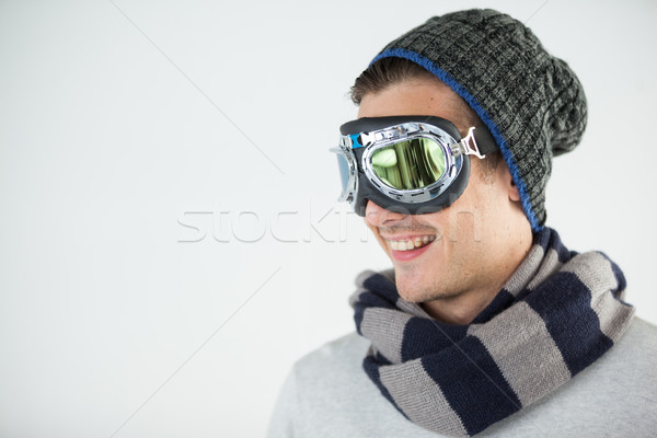Man in winter clothing wearing aviator goggles Stock photo © wavebreak_media