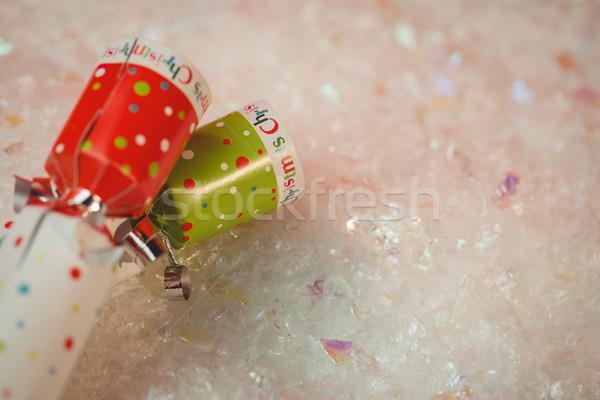 Close-up of christmas crackers on snow Stock photo © wavebreak_media