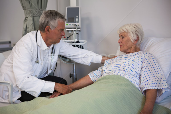 Doctor examining senior patient in ward Stock photo © wavebreak_media