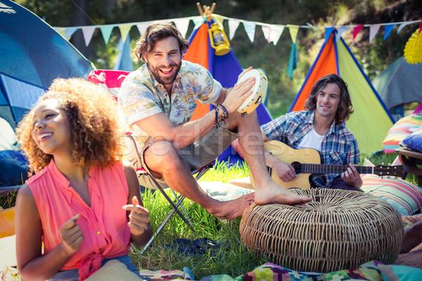 Barátok szórakozás együtt táborhely napos idő zene Stock fotó © wavebreak_media