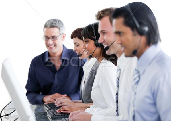 Business internazionale persone auricolare call center computer felice Foto d'archivio © wavebreak_media