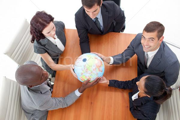 Magasról fotózva üzleti csapat tart földgömb üzletember megbeszélés Stock fotó © wavebreak_media
