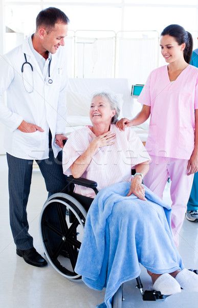 Smiling medical team taking care of a senior woman Stock photo © wavebreak_media