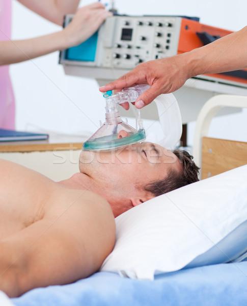 Doente paciente oxigênio hospital mulher médico Foto stock © wavebreak_media