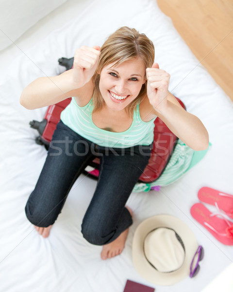 Successful woman trying to close her suitcase  Stock photo © wavebreak_media