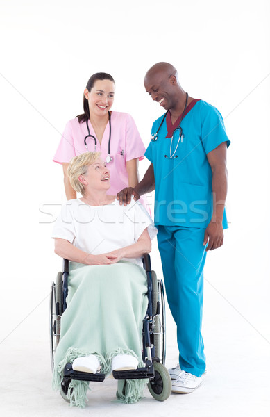 NUrse and doctor with a patient in a wheel chair Stock photo © wavebreak_media
