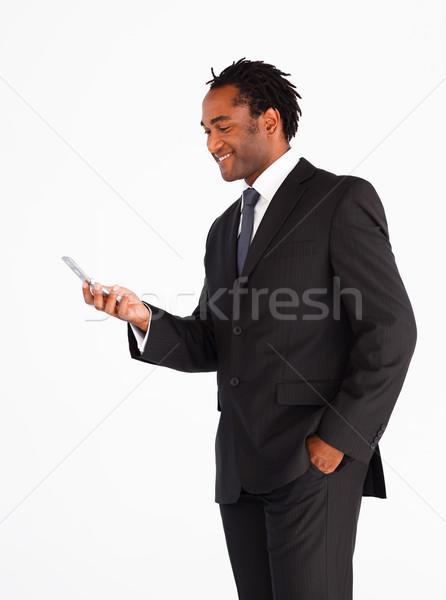 Jóképű üzletember küldés szöveges üzenet üzlet telefon Stock fotó © wavebreak_media