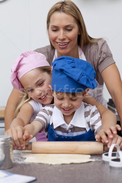 Mother and children baking cookies in the kitchen Stock photo © wavebreak_media