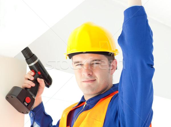 Gioioso elettricista potere piano lavoro Foto d'archivio © wavebreak_media