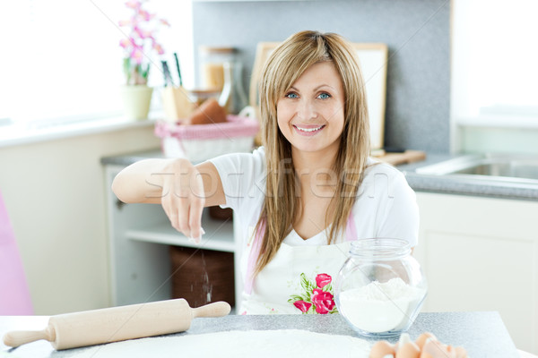 Attractive woman cooking cakes in the kitchen Stock photo © wavebreak_media