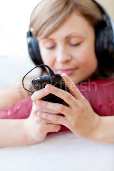 Csinos nő hallgat zene nappali otthon kő Stock fotó © wavebreak_media