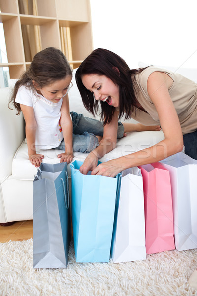 Happy Mother and daughter unpacking shopping bags in the living-room Stock photo © wavebreak_media