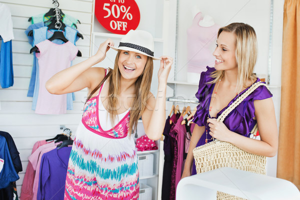 Jolly women choosing clothes together in a shop  Stock photo © wavebreak_media