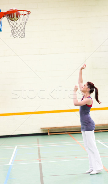 Gifted woman practicing basketball in a gymnasium Stock photo © wavebreak_media