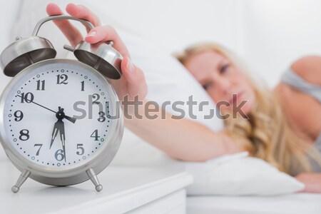 Serene man lying on his bed before being woken up by his alarm clock  Stock photo © wavebreak_media