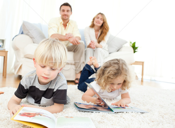 Childrens reading books in the living rooms Stock photo © wavebreak_media