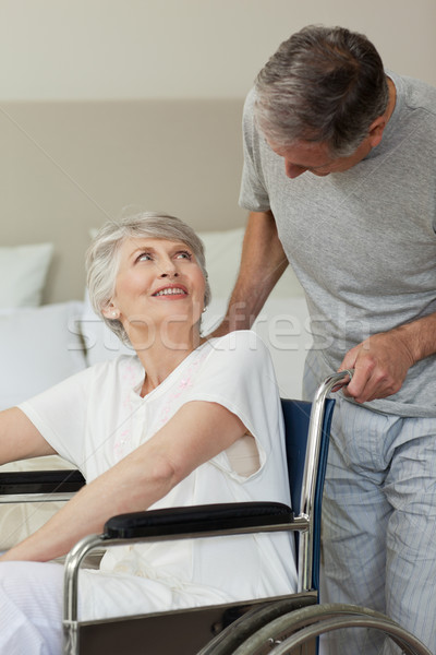 Retired woman in her wheelchair with her husband Stock photo © wavebreak_media