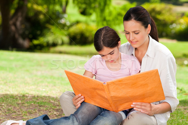 Daughter and her mother looking at their album photo Stock photo © wavebreak_media