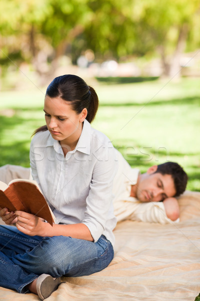 Woman reading while her husband is sleeping Stock photo © wavebreak_media