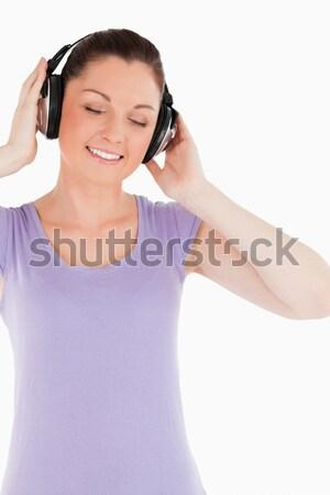 Güzel bir kadın kulaklık cd ayakta beyaz Stok fotoğraf © wavebreak_media