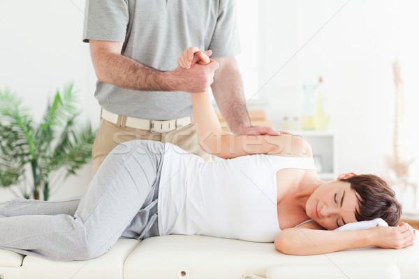 Chiropractor kadın kol cerrahi el Stok fotoğraf © wavebreak_media