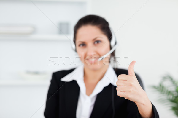 A beautiful businesswoman approving something with her thumb up Stock photo © wavebreak_media