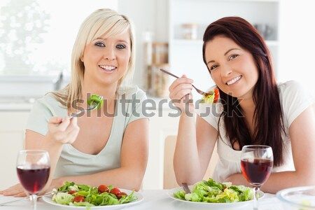 Cheerful women eating salad in a dining room Stock photo © wavebreak_media