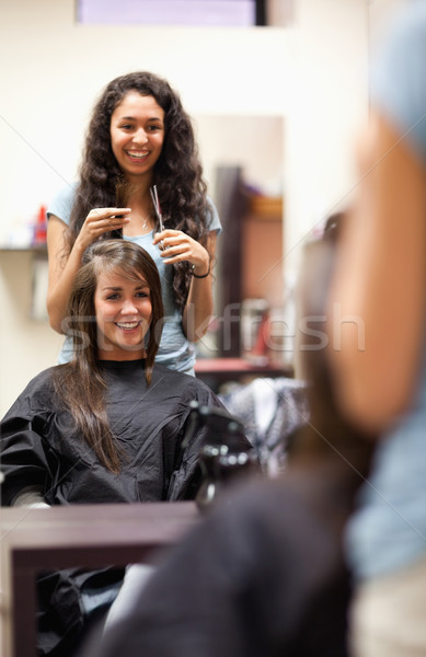 Portrait of a woman making a haircut standing up Stock photo © wavebreak_media