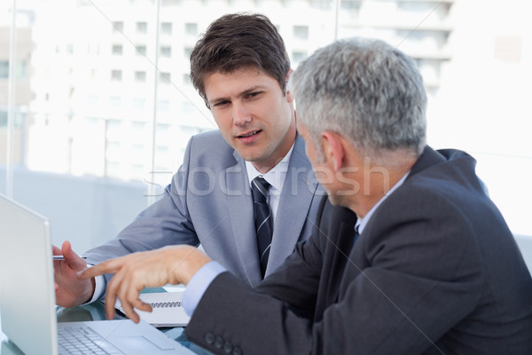 Senior salesman with money and his employees Stock photo © wavebreak_media