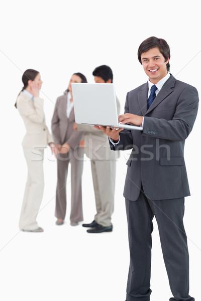 Souriant vendeur portable équipe derrière blanche Photo stock © wavebreak_media