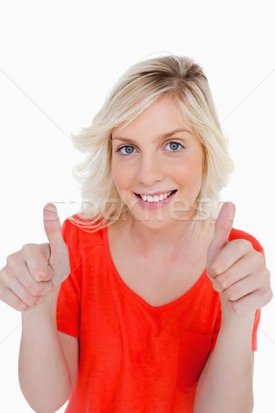 Tienermeisje glimlachend tonen witte mode Stockfoto © wavebreak_media