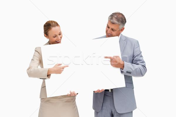 деловые люди указывая плакат белый улыбка Сток-фото © wavebreak_media
