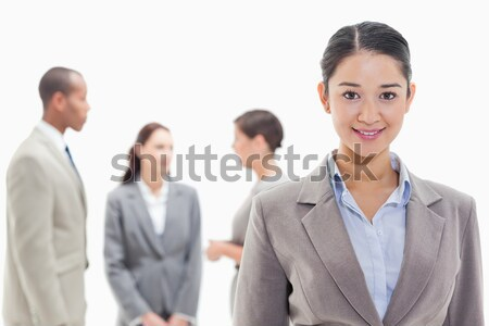 Close-up of a woman with business people applauding while watching her against white background Stock photo © wavebreak_media